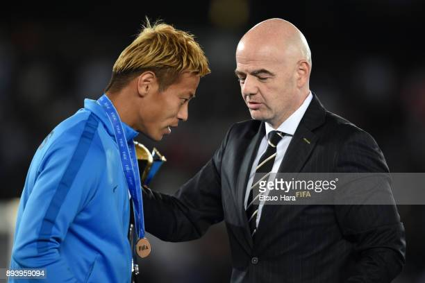 Keisuke Honda of Pachuca receives the medal from FIFA president Gianni Infantino during the medal ceremony after the FIFA Club World Cup UAE 2017...