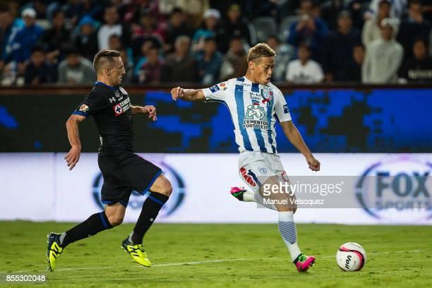 Keisuke Honda of Pachuca struggles for the ball against Christian Gimenez of Cruz Azul during the 11th round match between Pachuca and Cruz Azul as...