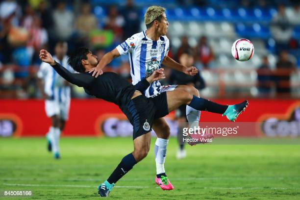 Keisuke Honda of Pachuca struggles for the ball with Oswaldo Alanis of Chivas during the 8th round match between Pachuca and Chivas as part of the...
