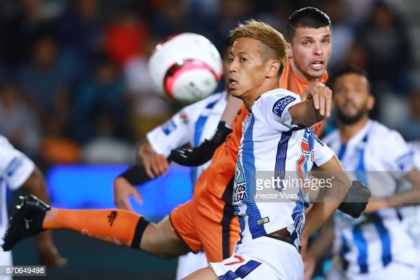 Keisuke Honda of Pachuca struggles for the ball with Tiago Volpi of Queretaro during the 16th round match between Pachuca and Queretaro as part of...