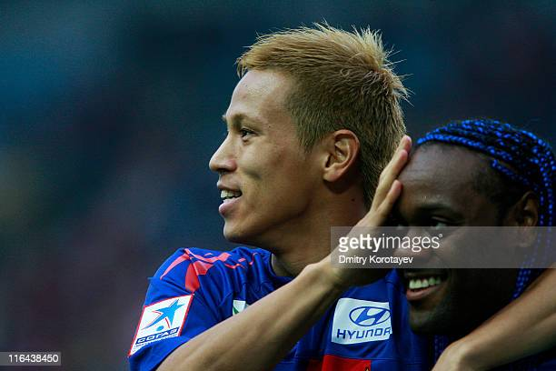 Keisuke Honda of PFC CSKA Moscow celebrates the first goal of Vagner Love during the Russian Football League Championship match between PFC CSKA...
