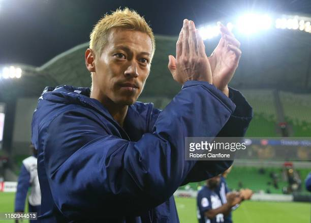 Keisuke Honda of the Victory acknowledges the fans after playing his last match for the club after the AFC Champions League Group Stage match between...