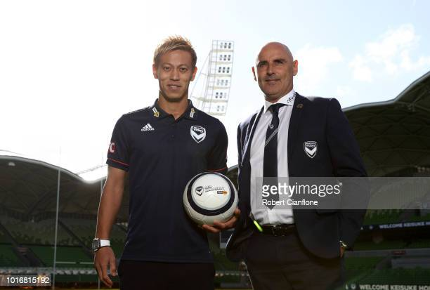 Keisuke Honda of the Victory and Victory coach Kevin Muscat pose for the media at a Melbourne Victory ALeague press conference at AAMI Park on August...
