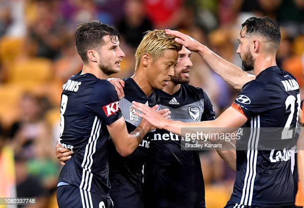 Keisuke Honda of the Victory celebrates scoring a goal during the round eight ALeague match between the Brisbane Roar and Melbourne Victory at...