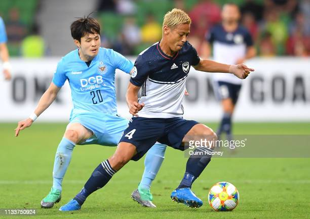 Keisuke Honda of the Victory controls the ball infront of Hwang Soonmin of Daegu during the AFC Champions League Group Stage match between Melbourne...