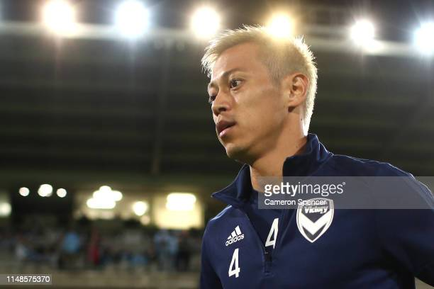 Keisuke Honda of the Victory heads out on the field to warm up during the A-League Semi Final match between Sydney FC and the Melbourne Victory at...