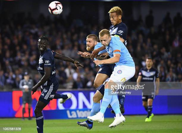 Keisuke Honda of the Victory heads the ball for a goal during the round one ALeague match between Melbourne Victory and Melbourne City at Marvel...