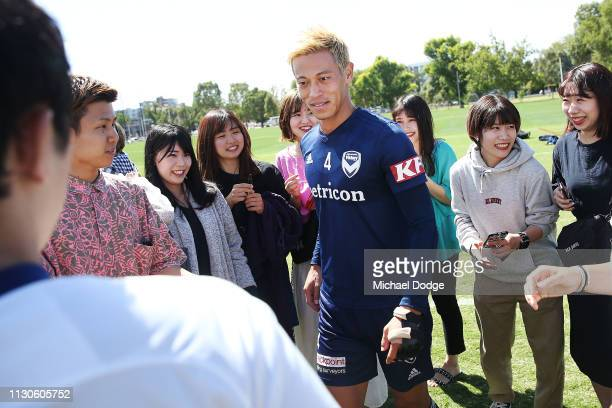 Keisuke Honda of the Victory is mobbed by his fans during the Melbourne Victory Training Session at Gosch's Paddock on February 19 2019 in Melbourne...