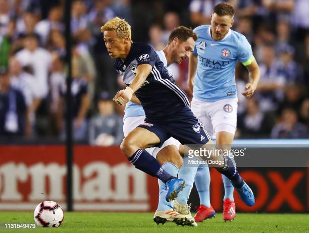 Keisuke Honda of the Victory is tackled by Rostyn Griffiths of the City during the Round 20 match between Melbourne Victory and Melbourne City at...