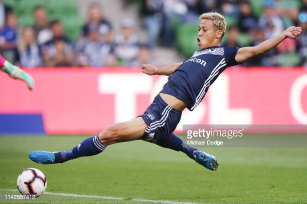 Keisuke Honda of the Victory kicks the ball at goal during the round 25 ALeague match between Melbourne Victory and the Central Coast Mariners at...