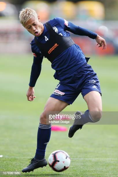 Keisuke Honda of the Victory passes the ball behind himself during a Melbourne Victory ALeague training session at Gosch's Paddock on December 04...