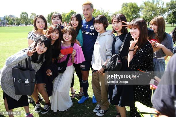Keisuke Honda of the Victory poses with his fans during the Melbourne Victory Training Session at Gosch's Paddock on February 19 2019 in Melbourne...