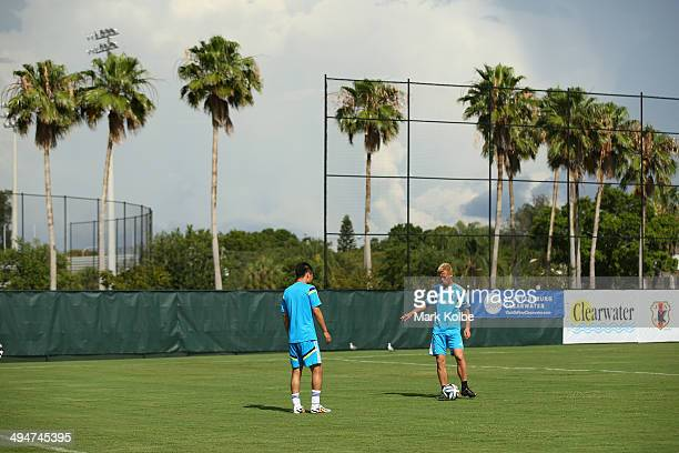 Keisuke Honda passes to Yasuyuki Konno during a Japan training session at North Greenwood Recreation Aquatic Complex on May 30 2014 in Clearwater...