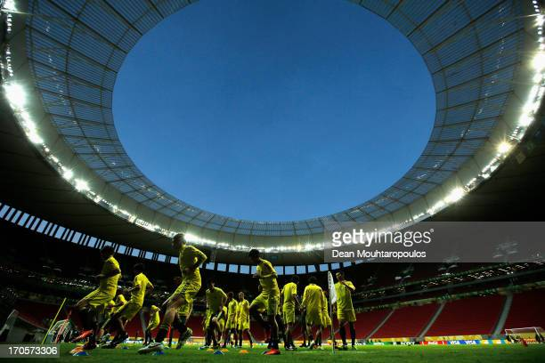 Keisuke Honda Shinji Kagawa and Yuto Nagatomo warm up with team mates under the stadium lights during the Japan Training Session for the FIFA...