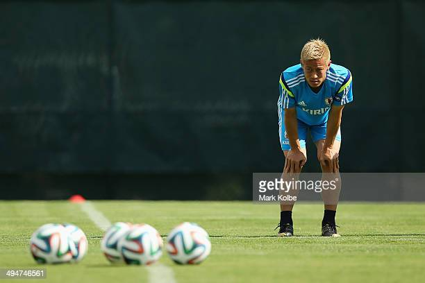 Keisuke Honda stretches during a Japan training session at North Greenwood Recreation Aquatic Complex on May 30 2014 in Clearwater Florida
