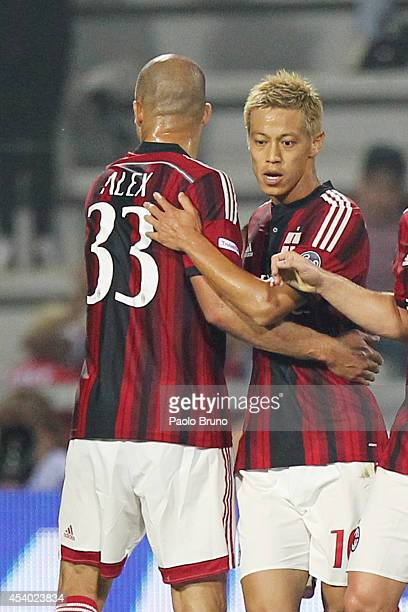Keisuke Honda with his teammate Alex of AC Milan celebrates after scoring the opening goal during the TIM Preseason Tournament between US Sassuolo FC...