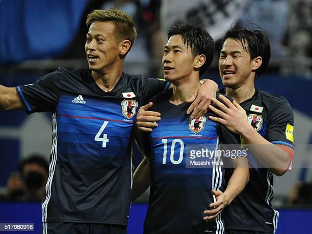 Keisuke HondaShinji Kagawa and Shinji Okazaki of Japan celebrate the second goal during the FIFA World Cup Russia Asian Qualifier second round match...