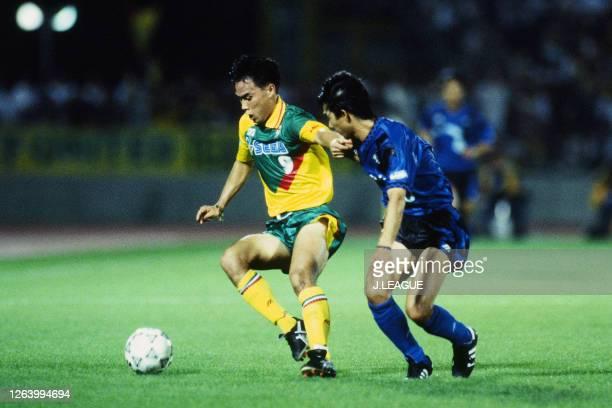 Keisuke Makino of JEF United Ichihara controls the ball under pressure of Takahiro Shimada of Gamba Osaka during the J.League Suntory Series match...