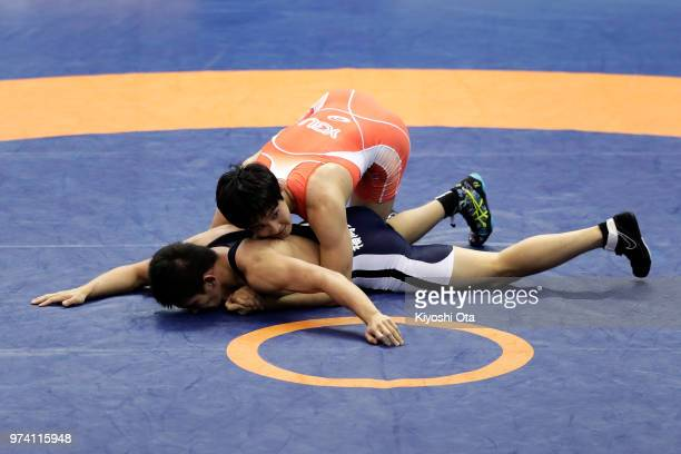 Keisuke Otoguro competes against Takumi Tamaoka in the Men's Freestyle 70kg second round match on day one of the All Japan Wrestling Invitational...