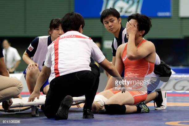 Keisuke Otoguro reacts after he was stopped to compete and lost the Men's Freestyle 70kg final against Jintaro Motoyama on day one of the All Japan...