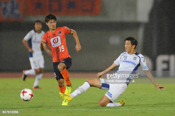 Keisuke Oyama of Omiya Ardija is tackled by Shun Nagasawa of Gamba Osaka during the JLeague J1 match between Omiya Ardija and Gamba Osaka at Kumagaya...
