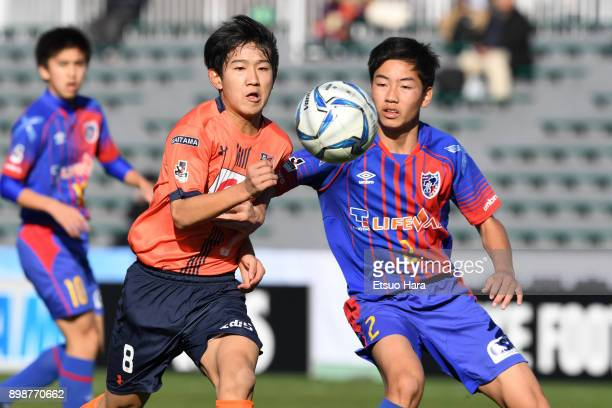 Keisuke Sato of FC Tokyo and Naoki Suto of Omiya Ardija compete for the ball during the Prince Takamado Cup 29th All Japan Youth Football Tournament...