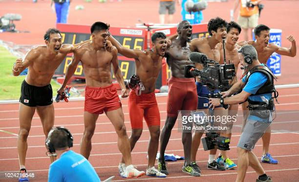 Keisuke Ushiro of Japan and athletes embrace after competing in the Men's Decathlon at the GBK Main Stadium on day eight of the Asian Games on August...
