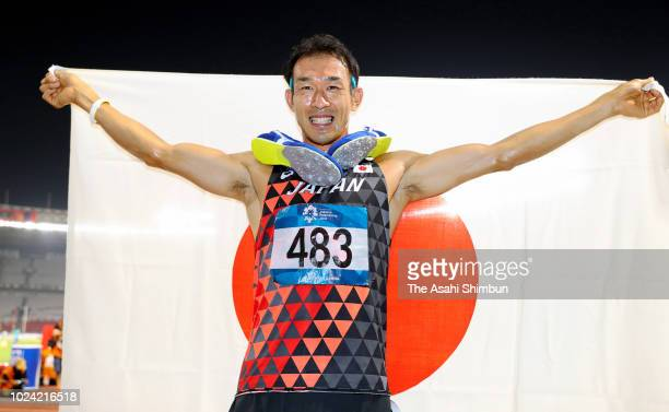 Keisuke Ushiro of Japan celebrates winning the gold medal in the Men's Decathlon at the GBK Main Stadium on day eight of the Asian Games on August...
