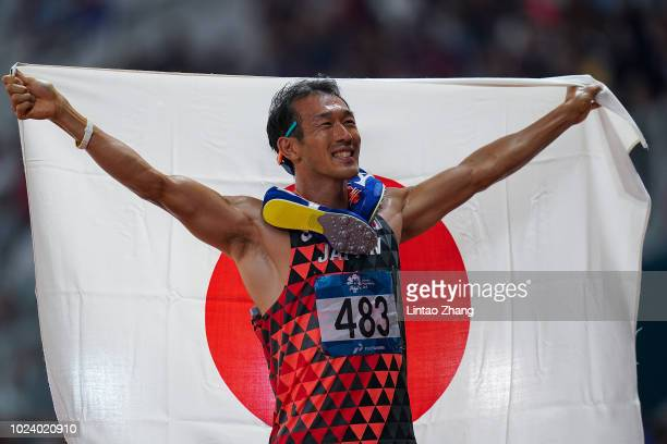 Keisuke Ushiro of Japan celebrates winning the men's decathlon athletics event on day eight of the Asian Games on August 26, 2018 in Jakarta,...