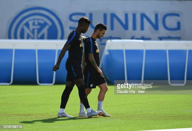 Keita Balde Diao and Matteo Politano of FC Internazionale chat during the FC Internazionale training session at the club's training ground Suning...