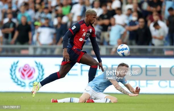 Keita Balde of Cagliari Calcio battles for possession with Manuel Lazzari of SS Lazio during the Serie A match between SS Lazio and Cagliari Calcio...