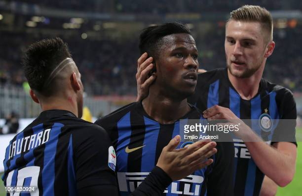 Keita Balde of FC Internazionale celebrates with his teammates Milan Skriniar and Lautaro Martinez after scoring the opening goal during the Serie A...