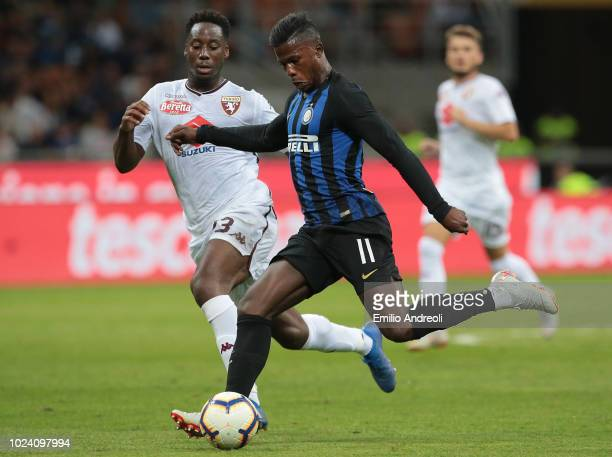 Keita Balde of FC Internazionale is challenged by Soualiho Meite of Torino FC during the serie A match between FC Internazionale and Torino FC at...