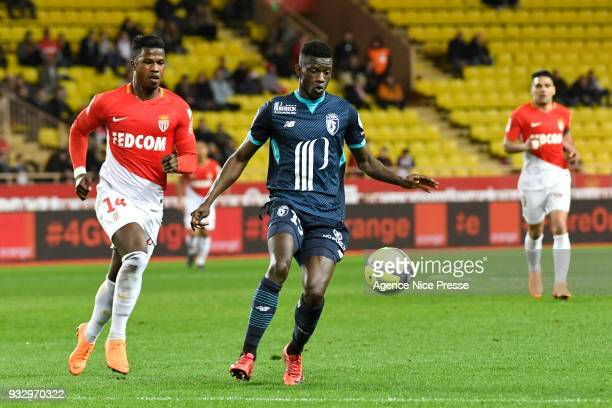 Keita Balde of Monaco and Edgar Ie of Lille during the Ligue 1 match between AS Monaco and Lille OSC at Stade Louis II on March 16 2018 in Monaco
