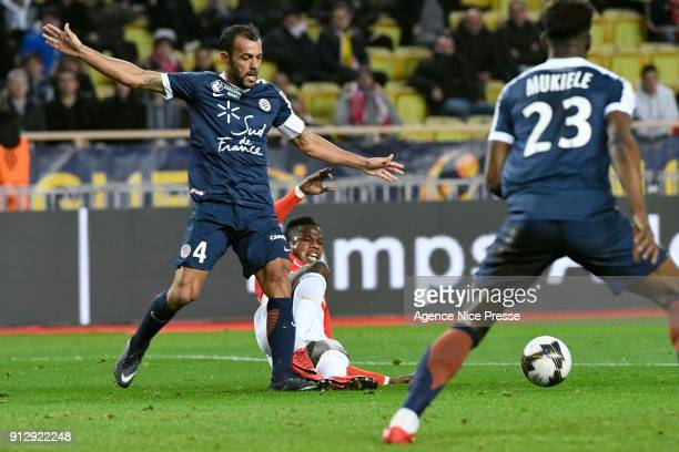 Keita Balde of Monaco and Hilton of Montpellier during the League Cup semi final match between Monaco and Montpellier at Stade Louis II on January 31...