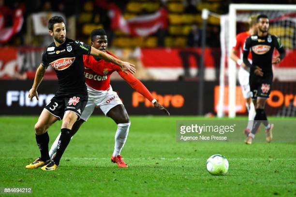 Keita Balde of Monaco and Yoann Andreu of Angers during the Ligue 1 match between AS Monaco and Angers SCO at Stade Louis II on December 2 2017 in...