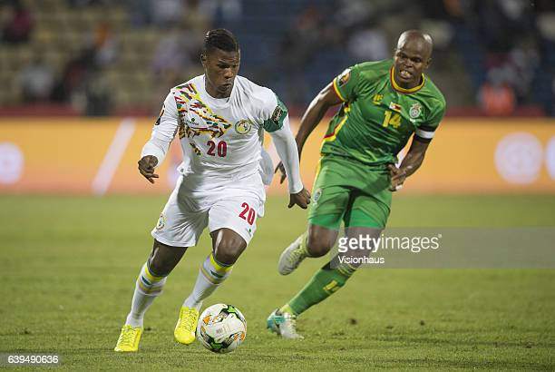 Keita Balde of Senegal and Willard Katsande of Zimbabwe during the Group B match between Senegal and Zimbabwe at Stade Franceville on January 19 2017...