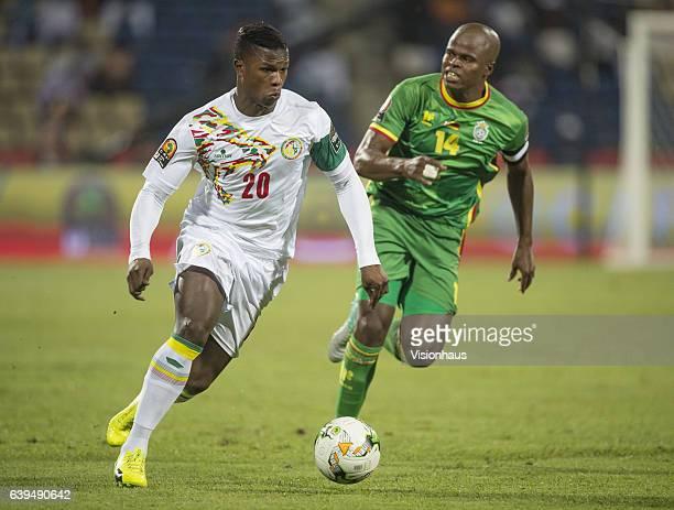 Keita Balde of Senegal and Willard Katsande of Zimbabwe during the Group B match between Senegal and Zimbabwe at Stade Franceville on January 19 2017...