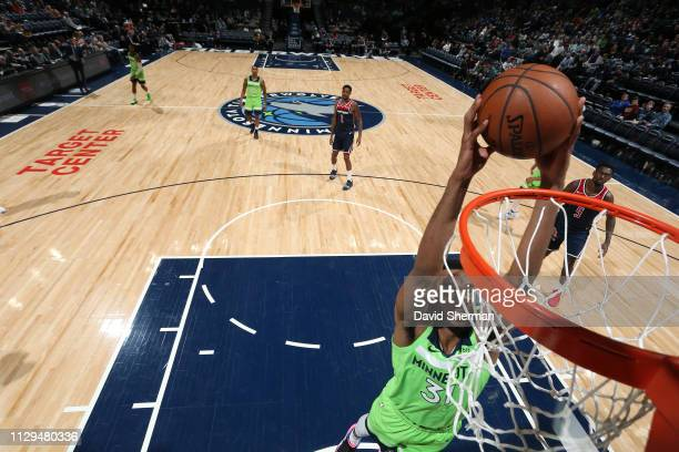 Keita BatesDiop of the Minnesota Timberwolves goes up for a dunk during the game against the Minnesota Timberwolves on March 9 2019 at Target Center...