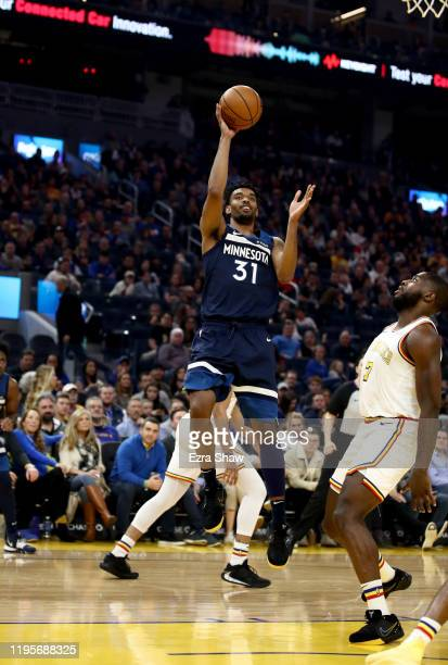 Keita BatesDiop of the Minnesota Timberwolves shoots over Eric Paschall of the Golden State Warriors at Chase Center on December 23 2019 in San...