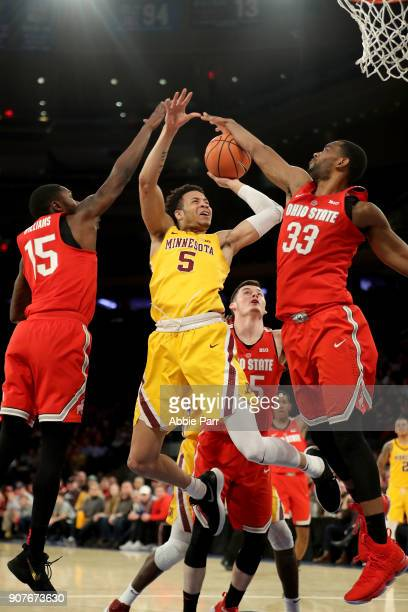 Keita BatesDiop of the Ohio State Buckeyes blocks a shot by Amir Coffey of the Minnesota Golden Gophers in the first half during their game at...