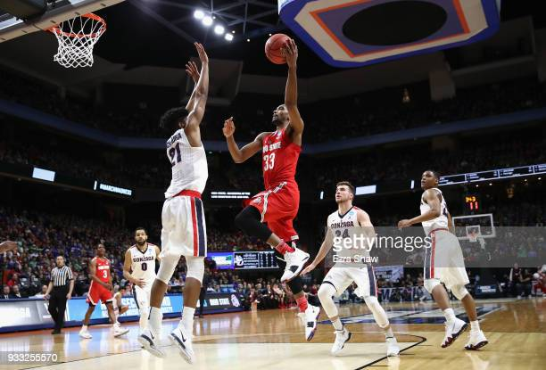 Keita BatesDiop of the Ohio State Buckeyes drives to the basket against Rui Hachimura of the Gonzaga Bulldogs during the first half in the second...