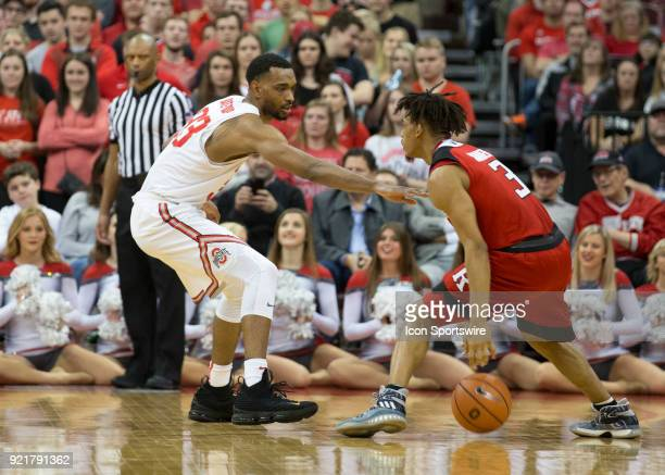 Keita BatesDiop of the Ohio State Buckeyes guards Corey Sanders of the Rutgers Scarlet Knights during the game between the Ohio State Buckeyes and...