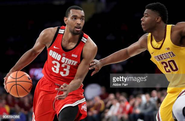 Keita BatesDiop of the Ohio State Buckeyes works the ball against Davonte Fitzgerald of the Minnesota Golden Gophers in the second half during their...