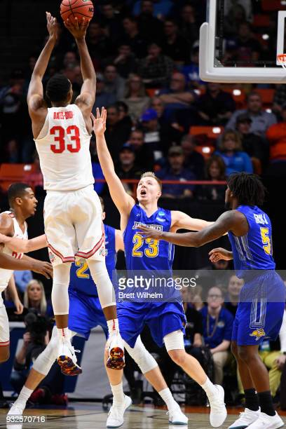Keita BatesDiop of the Ohio State University shoots for 3 while guarded by Reed Tellinghuisen of the South Dakota State University during the First...