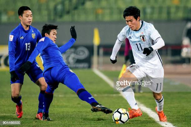 Keita Endo of Japan controls the ball during the AFC U23 Championship Group B match between Thailand and Japan at Jiangyin Stadium on January 13 2018...