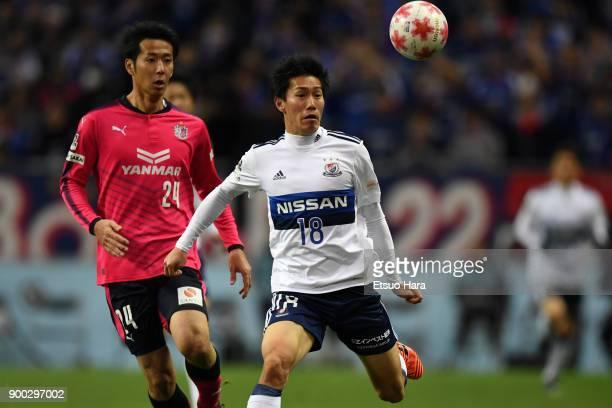 Keita Endo of Yokohama F.Marinos and Kazuya Yamamura of Cerezo Osaka compete for the ball during the 97th All Japan Football Championship final...