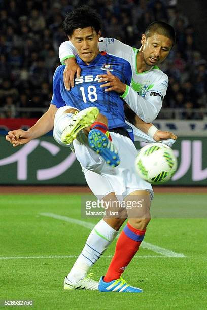 Keita Endo of Yokohama FMarinos and Keisuke Tsuboi of Shonan Bellmare compete for the ball during the JLeague match between Yokohama FMarinos and...