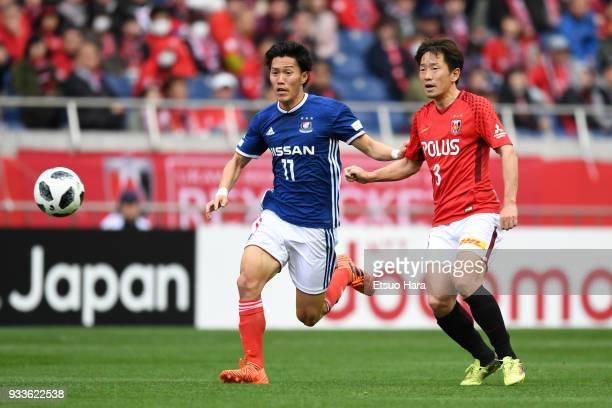 Keita Endo of Yokohama FMarinos and Tomoya Ugajin of Urawa Red Diamonds compete for the ball during the JLeague J1 match between Urawa Red Diamonds...
