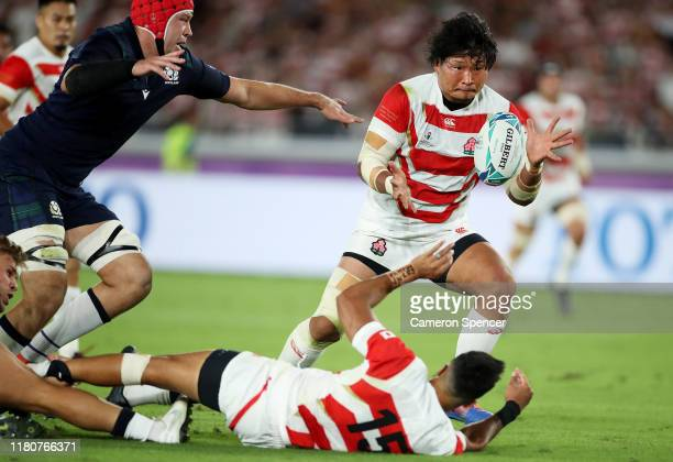 Keita Inagaki of Japan collects a pass as he scores their second try during the Rugby World Cup 2019 Group A game between Japan and Scotland at...